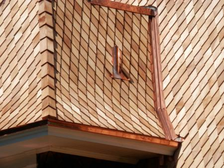 Fancy shingle designs can create a striking look for your home.